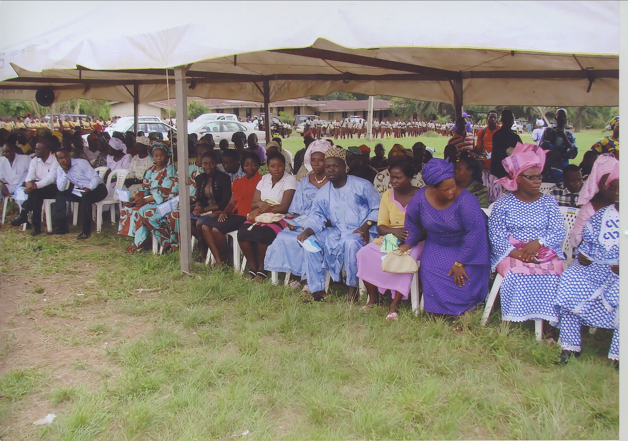 Cross Section Of Attendees Of The New School Building Commissioning Ceremony