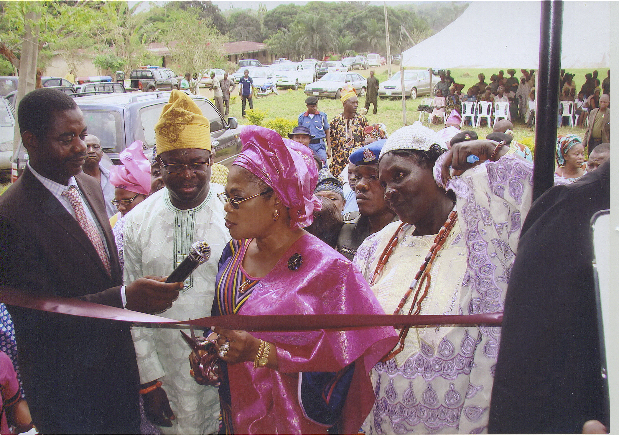 Cutting Of Ribbon With The Deputy Governor Of Osun State, The Regent Of Ere-Ijesha And Dr Ajifolokun Surrounded By Other Dignitaries.